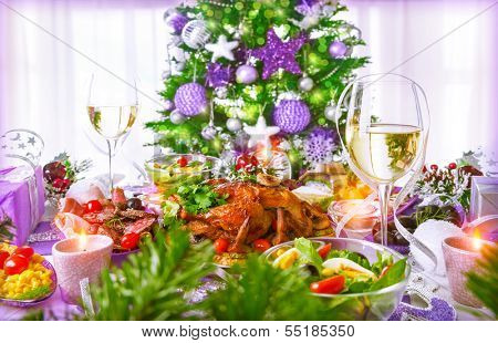 Christmastime dinner with backed chicken, various of dish and traditional Christmas drink, champagne, New Year eve concept