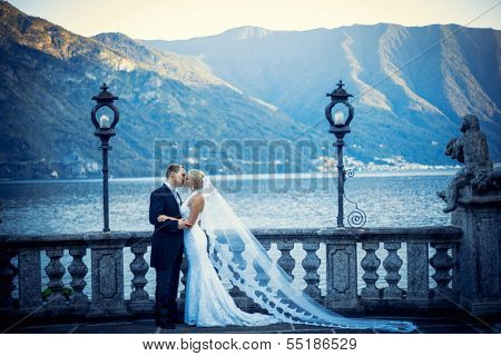 Young newly wed couple in a landscape