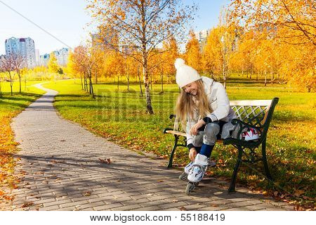 Girl Putting On Roller Blades