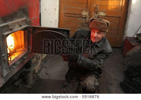 Stoker Poses In Stokehole