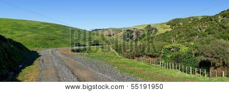 Panoramic View Of A Road Through Rolling Hills With Native Bushland