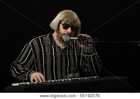 Musician Is Closing His Eyes While Sings