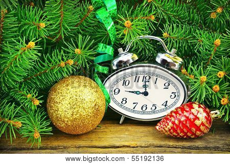 Christmas Tree, Watches, Toys And Wooden Background.