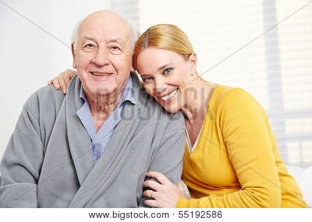 Happy family with woman embracing senior citizen man