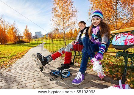 Kids Putting On Roller Blades