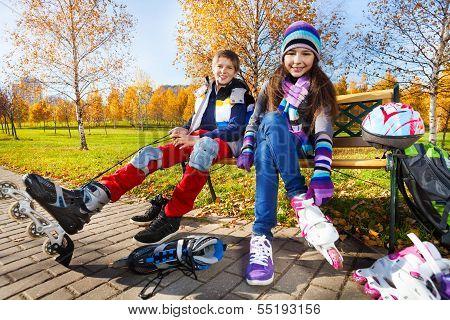 Couple Kids Skating