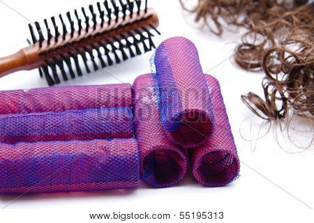 Brown Wooden hairbrush with Haircurler and Hair Wig  on white background