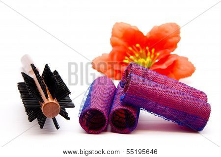 Brown Wooden hairbrush with Haircurler on white background