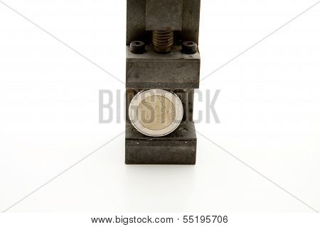Machine vise with Coin on white background
