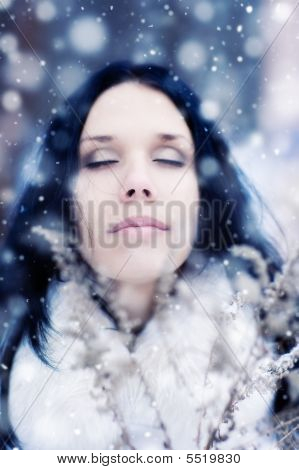 Young Woman Tender Portrait With Snow