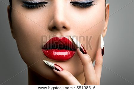Fashion Beauty Model Girl. Manicure and Make-up. Nail art. Beautiful Woman With Red Nails and Lips. Luxury Makeup. Beautiful Girl Face and Hand close-up. Perfect Skin