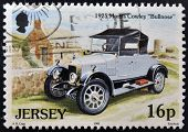 A stamp printed in Jersey shows a car 1925 Morris Cowley Bullnose