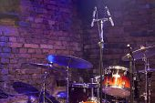 picture of drum-kit  - Drum Kit and Microphone on a brick stage - JPG