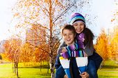 image of 11 year old  - Happy and laughing 10 and 11 years old couple of school kids boy an girl in warm autumn clothes in the park - JPG