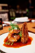 stock photo of chinese wok  - Wok fried shrimps with sweet sauce and coriander leaves - JPG