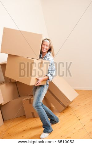 Moving House: Woman Holding Heavy Carton Box
