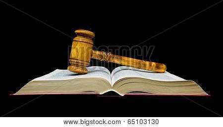 Gavel Lies On The Open Book. Black Background.