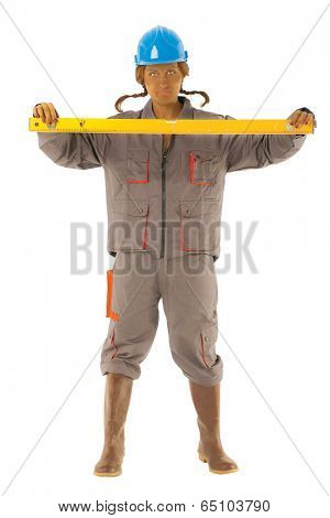 young woman with protective helmet and uniform holding level isolated with work path