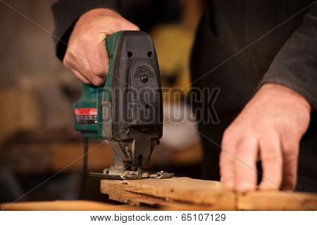Elderly Carpenter Working In His Workshop