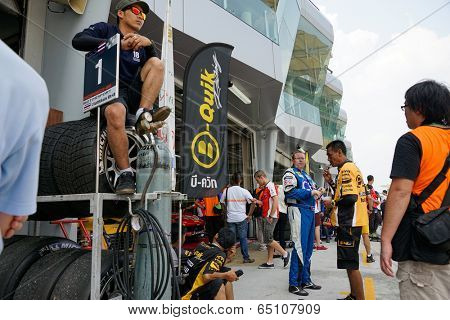 SEPANG, MALAYSIA - MAY 11, 2014: The team mechanics and pit crew wait at the pit lane preparing for the next race at the Thailand Super Series Round 1 held in Sepang International Circuit, Malaysia.