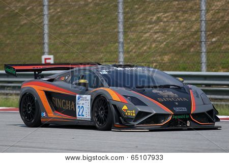 SEPANG, MALAYSIA - MAY 11, 2014: Driver Sanchai Engtrakul in a Lamborghini LP600 car races down the straights of the Sepang International Circuit during the Thailand Super Car GT3 race.