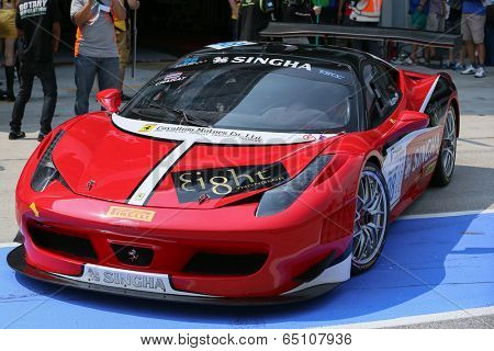 SEPANG, MALAYSIA - MAY 11, 2014: Driver Chairat Sangtong in a Ferrari 458 car leaves for the tracks to start the Thailand Supercar GTM race at the Sepang International Circuit, Malaysia.