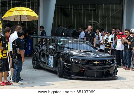 SEPANG, MALAYSIA - MAY 11, 2014: Tomas Enge in a Chevrolet Camaro GT3 car leaves for the tracks to start the Thailand Supercar GT3 race at the Sepang International Circuit, Malaysia.