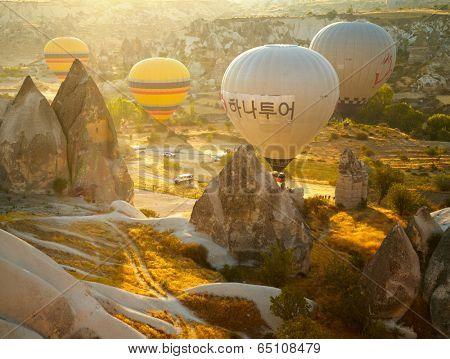 GOREME, TURKEY - AUGUST 25: Hot air balloon fly over Cappadocia on august 25, 2013 in Goreme, Cappadocia, Turkey