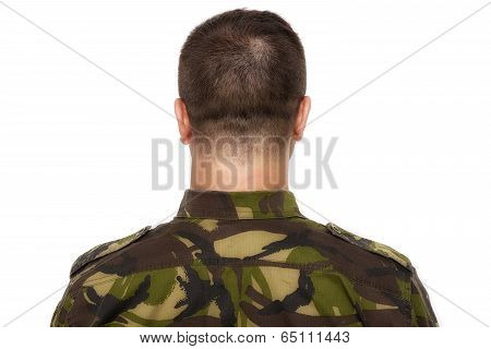 Soldier In Camouflage Standing On A White Background