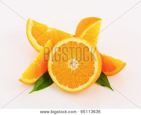 overhead view of cut orange with green leaves