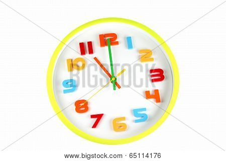 Colorful Clock In Telling Time Of Eleven O'clock.