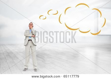 Thinking businessman with thought bubble against room with holographic cloud