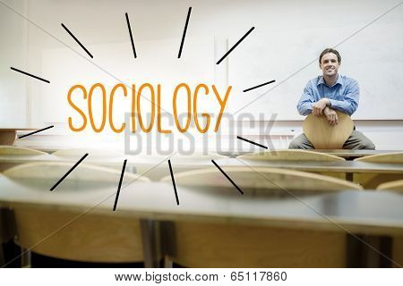 The word sociology against lecturer sitting in lecture hall