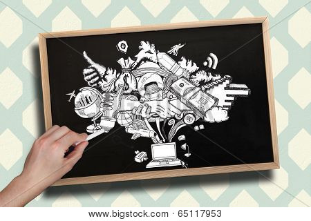 Composite image of hand drawing computing graphic with chalk on chalkboard with wooden frame