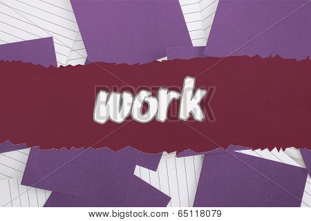 The word work against purple paper strewn over notepad