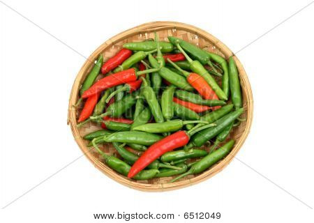 Red And Green Chillis In A Bamboo Tray