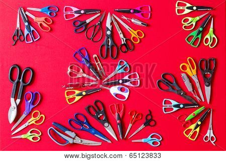 Random Groups Of Multiple Scissors Conceptualy Laid On Red