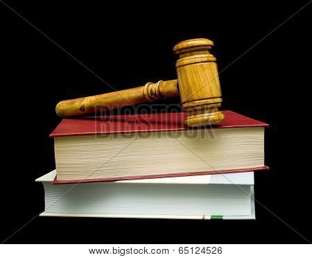 Books And Gavel Isolated On A Black Background