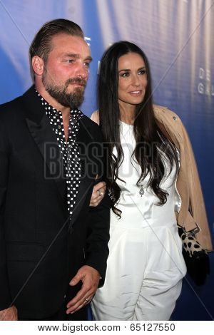 LOS ANGELES - MAY 15:  Brian Bowen Smith, Demi Moore at the De Re Gallery Opening at De Re Gallery on May 15, 2014 in West Hollywood, CA