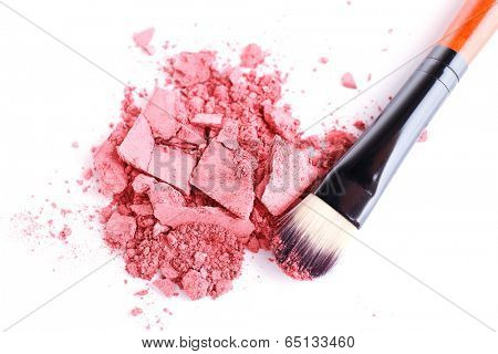 Crushed eyeshadow with brush isolated on white