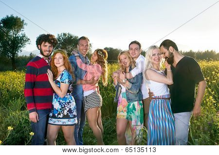 Group Of Four Affectionate Young Couples
