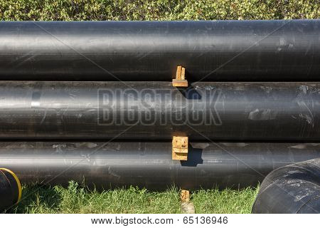 Stack of black pipes