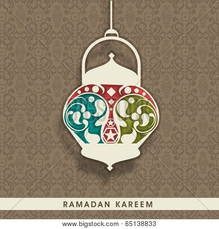 Colorful Arabic lantern hanging on seamless brown background with floral pattern, elegant greeting card design for holy month of Ramadan Kareem.