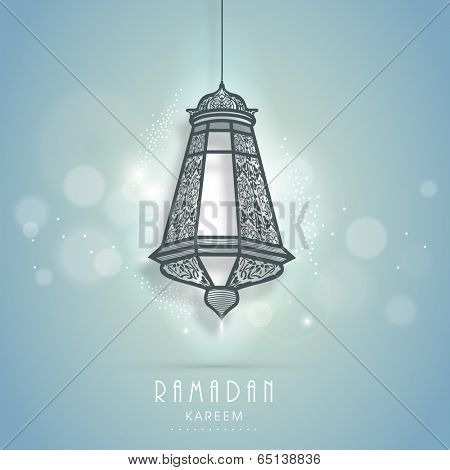 Beautiful floral decorate arabic lamp or lantern on shiny blue background, creative greeting card design for holy month of Ramadan Kareem.