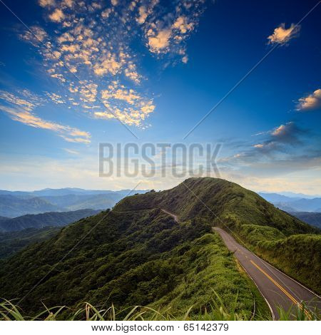 beautiful mountain road with sky