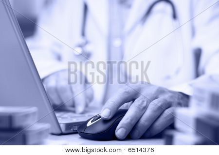 Doctor Preparing Online Internet Medical Record