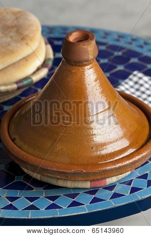 Moroccan tagine and bread on the table