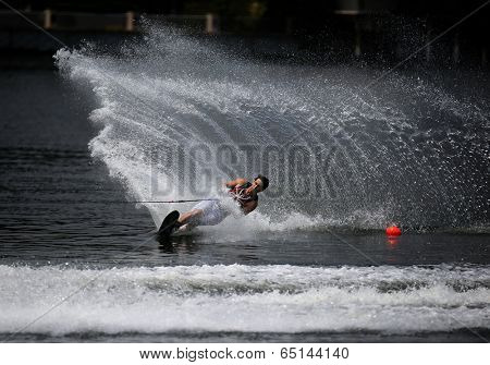 PUTRAJAYA, MALAYSIA - APRIL 26, 2014: Itt Nattawut Hapholdee of Thailand rides the waves at the Slalom Open event at the Putrajaya Nautique Ski & Wake Championship 2014.
