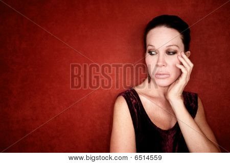 Apprehensive Woman On Red Background
