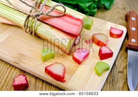 Rhubarb Cut And Knife On Board